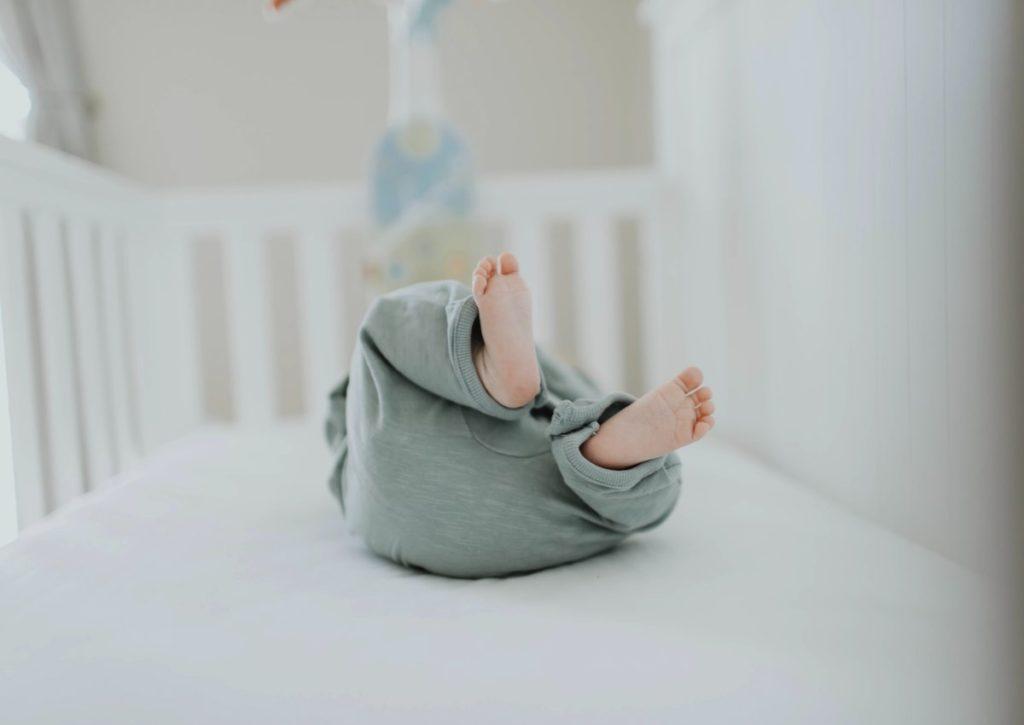 dark rooms for baby sleep baby feet in a crib
